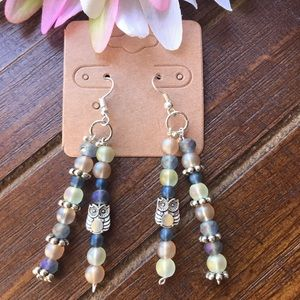 Purple, coral and white dangling owl earrings.